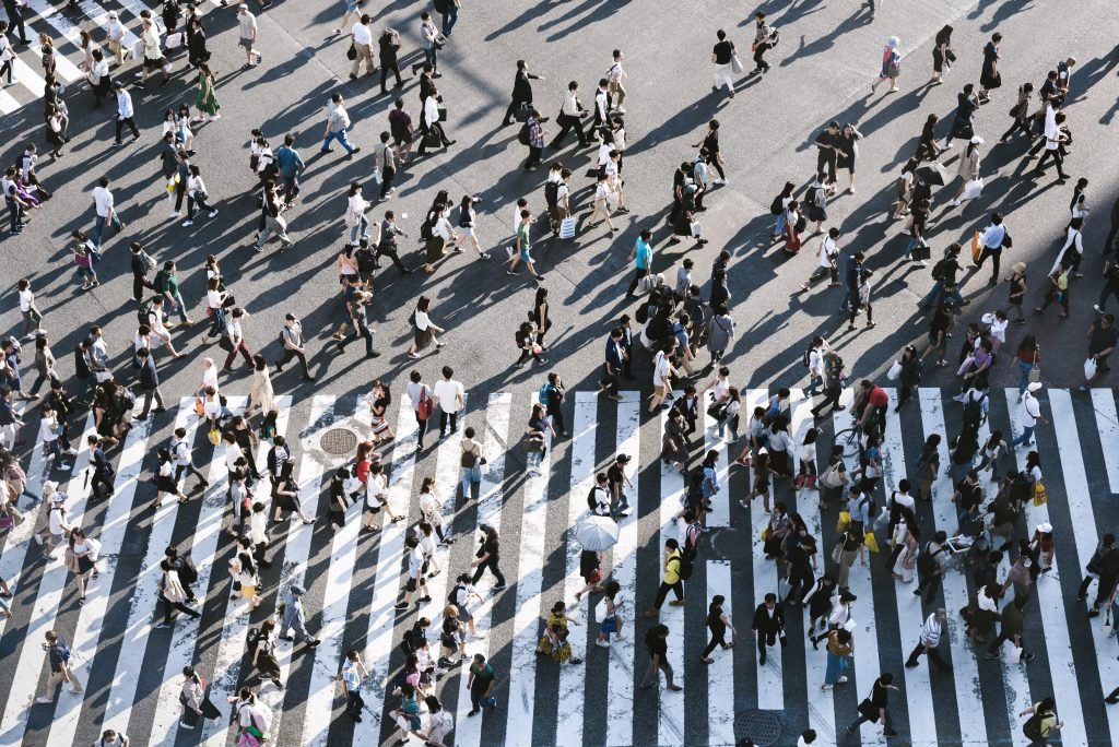 Aerial view of pedestrian crowd crossing a street