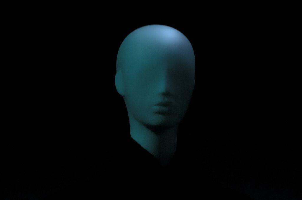 Mannequin head against black backdrop