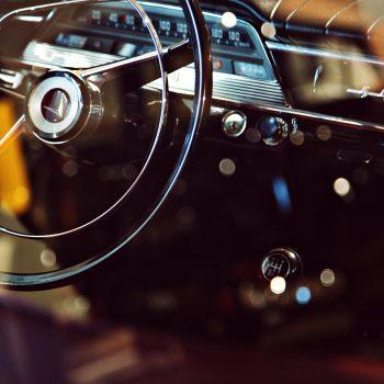 Close up of steering wheel inside vintage vehicle